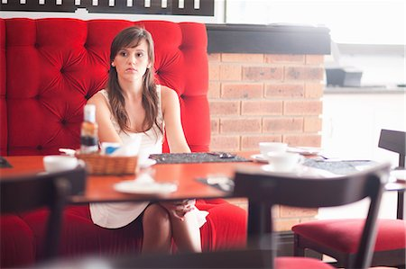 Woman sitting in cafe Stock Photo - Premium Royalty-Free, Code: 614-06537239