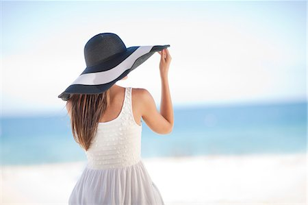 Woman wearing floppy hat on beach Stock Photo - Premium Royalty-Free, Code: 614-06537232