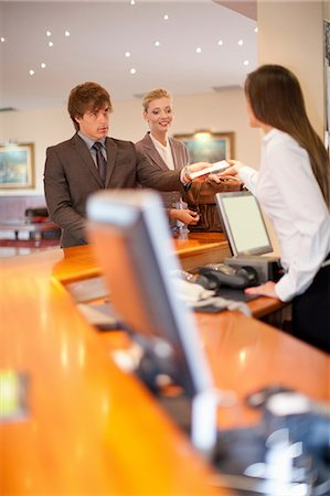 Business people checking into hotel Stock Photo - Premium Royalty-Free, Code: 614-06537248