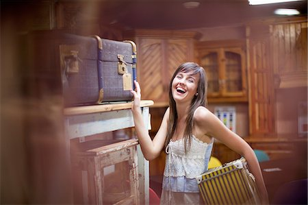 Woman shopping in thrift store Stock Photo - Premium Royalty-Free, Code: 614-06537269