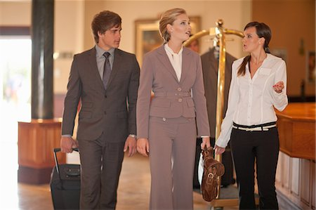 Business people walking in hotel lobby Stock Photo - Premium Royalty-Free, Code: 614-06537260
