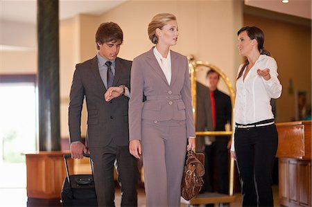 Business people walking in hotel lobby Stock Photo - Premium Royalty-Free, Code: 614-06537261