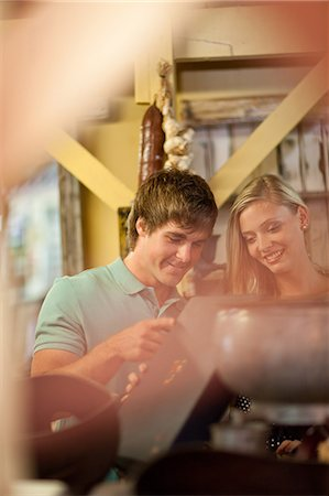 Couple shopping together in thrift store Stock Photo - Premium Royalty-Free, Code: 614-06537279