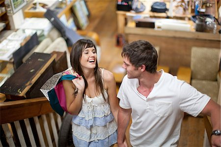 Couple shopping together in thrift store Stock Photo - Premium Royalty-Free, Code: 614-06537270
