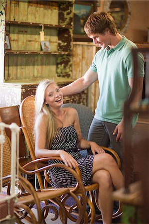 Couple shopping together in thrift store Stock Photo - Premium Royalty-Free, Code: 614-06537271