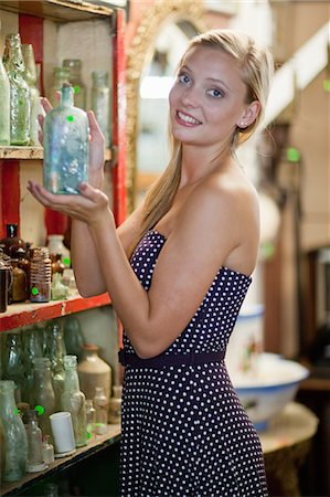 Woman shopping in thrift store Stock Photo - Premium Royalty-Free, Code: 614-06537284