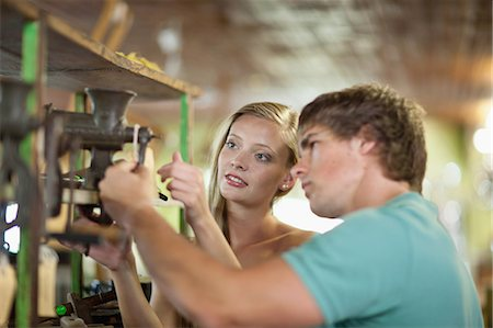 Couple shopping together in thrift store Stock Photo - Premium Royalty-Free, Code: 614-06537286