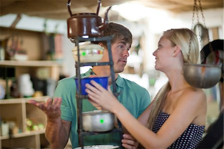 Couple shopping together in thrift store Stock Photo - Premium Royalty-Free, Code: 614-06537281