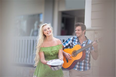 Couple playing music on street Stock Photo - Premium Royalty-Free, Code: 614-06537300