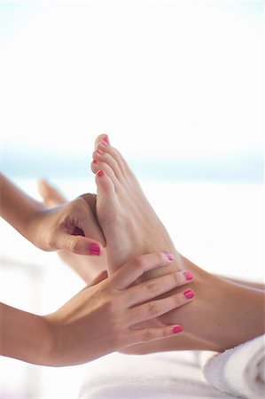 foot massage - Woman having foot massage Stock Photo - Premium Royalty-Free, Code: 614-06537316
