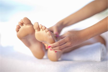 foot massage - Woman having foot massage Stock Photo - Premium Royalty-Free, Code: 614-06537317