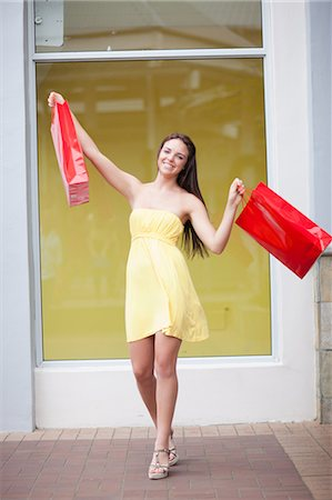 Woman carrying shopping bags Stock Photo - Premium Royalty-Free, Code: 614-06537311