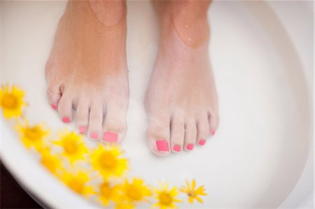 Woman's feet soaking in tub Stock Photo - Premium Royalty-Free, Code: 614-06537327