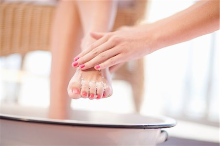 Woman having salt scrub on feet Stock Photo - Premium Royalty-Free, Code: 614-06537329