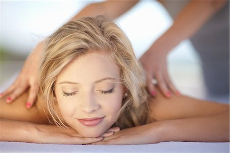 Smiling woman having massage Stock Photo - Premium Royalty-Free, Code: 614-06537320