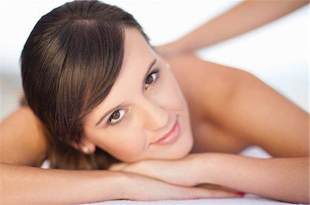 Smiling woman having massage Stock Photo - Premium Royalty-Free, Code: 614-06537322