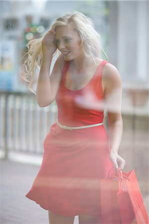 shopping mall - Woman window shopping on street Stock Photo - Premium Royalty-Free, Code: 614-06537344