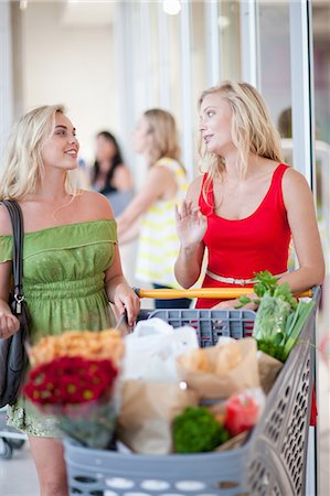 Women pushing shopping cart Stock Photo - Premium Royalty-Free, Code: 614-06537355