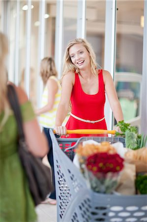 Women pushing shopping cart Stock Photo - Premium Royalty-Free, Code: 614-06537358