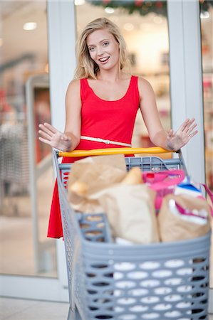 Women pushing shopping cart Stock Photo - Premium Royalty-Free, Code: 614-06537362
