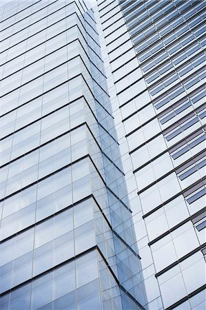 Low angle view of urban skyscraper Stock Photo - Premium Royalty-Free, Code: 614-06537386