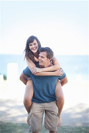 Man carrying girlfriend on beach Stock Photo - Premium Royalty-Free, Code: 614-06537391