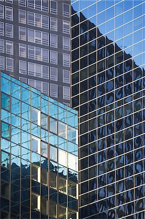 Buildings reflected in urban skyscrapers Stock Photo - Premium Royalty-Free, Code: 614-06537424
