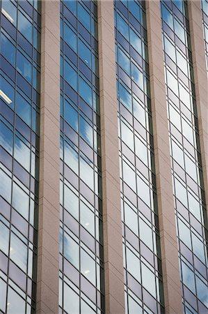 Close up of urban skyscraper Stock Photo - Premium Royalty-Free, Code: 614-06537430
