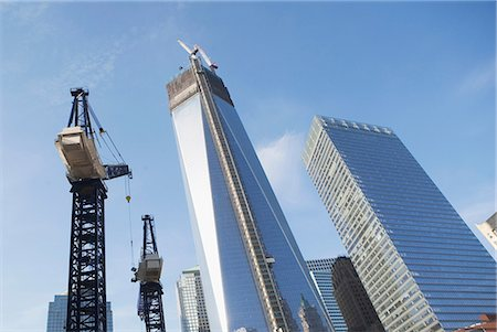 Low angle view of crane and skyscrapers Stock Photo - Premium Royalty-Free, Code: 614-06537441