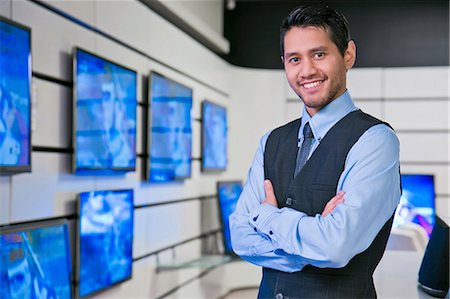 sale - Salesman smiling in store Stock Photo - Premium Royalty-Free, Code: 614-06537461