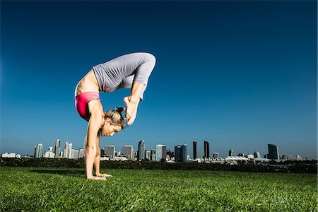 southern california - Woman practicing yoga in urban park Stock Photo - Premium Royalty-Free, Code: 614-06537477