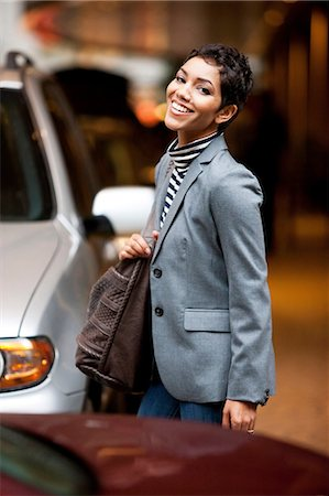 residential - Businesswoman walking in parking lot Stock Photo - Premium Royalty-Free, Code: 614-06537480
