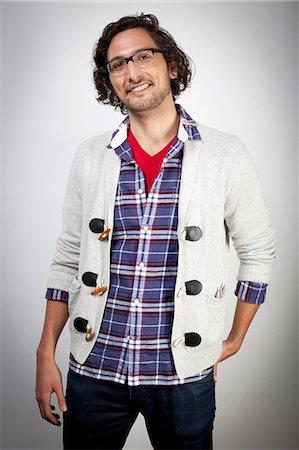 patterned - Smiling man wearing glasses Stock Photo - Premium Royalty-Free, Code: 614-06537499