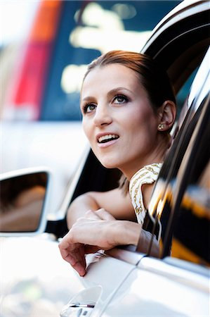expressive - Woman looking out car window Stock Photo - Premium Royalty-Free, Code: 614-06537508