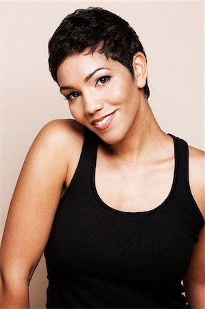 short hair - Smiling woman standing indoors Stock Photo - Premium Royalty-Free, Code: 614-06537559