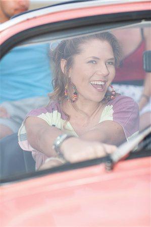 Smiling woman driving convertible Stock Photo - Premium Royalty-Free, Code: 614-06537588