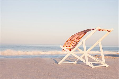 Lawn chair on empty beach Stock Photo - Premium Royalty-Free, Code: 614-06537582