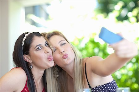 pucker - Smiling women taking pictures together Stock Photo - Premium Royalty-Free, Code: 614-06537609