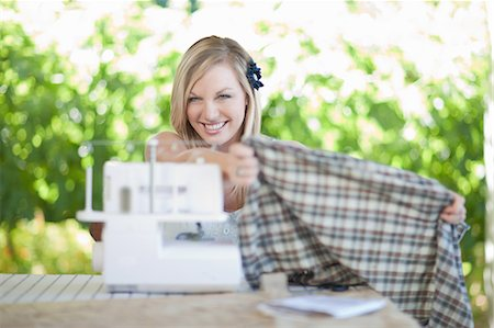 Woman working on sewing machine Stock Photo - Premium Royalty-Free, Code: 614-06537635