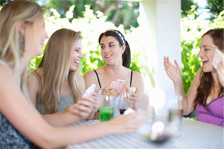 Women playing cards at table Stock Photo - Premium Royalty-Free, Code: 614-06537632