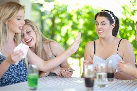Women playing cards at table Stock Photo - Premium Royalty-Free, Code: 614-06537633
