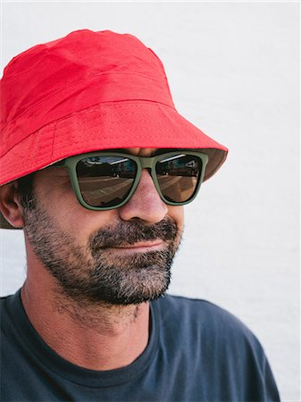 Man wearing hat and sunglasses Stock Photo - Premium Royalty-Free, Code: 614-06537669