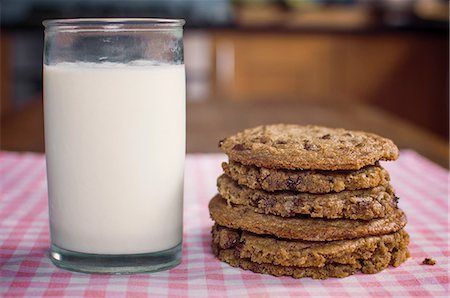 Stack of chocolate chip cookies and milk Stock Photo - Premium Royalty-Free, Code: 614-06537660