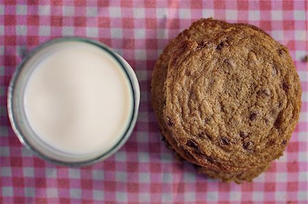 Stack of chocolate chip cookies and milk Stock Photo - Premium Royalty-Free, Code: 614-06537661