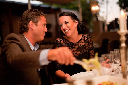 romanticism - Couple having dinner in restaurant Stock Photo - Premium Royalty-Free, Code: 614-06624024