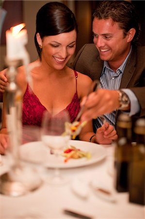 Couple having dinner in restaurant Stock Photo - Premium Royalty-Free, Code: 614-06624023