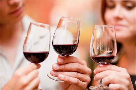Friends tasting wine in grocery Stock Photo - Premium Royalty-Free, Code: 614-06624078