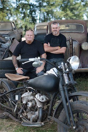 Men sitting with motorcycle Stock Photo - Premium Royalty-Free, Code: 614-06624131