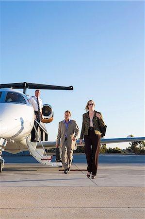 Business people on airplane runway Stock Photo - Premium Royalty-Free, Code: 614-06624356