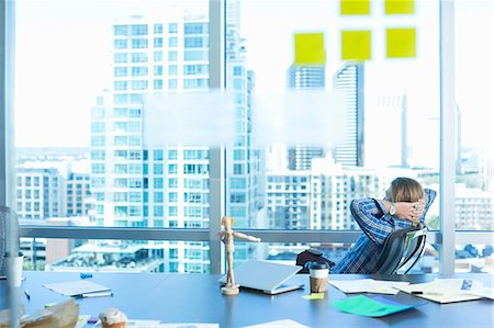 self adhesive note - Businessman relaxing at desk in office Stock Photo - Premium Royalty-Free, Code: 614-06624387